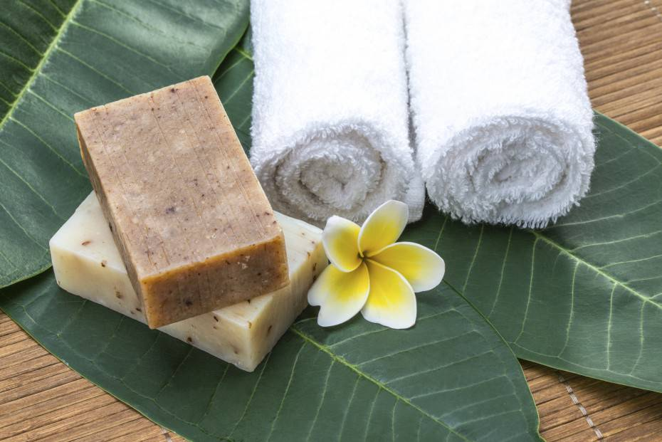 soap, towel, flower, on green leaves for health spa material