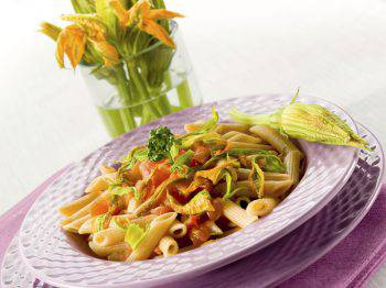 pasta with zucchinis flower and fresh tomatoes,healthy food