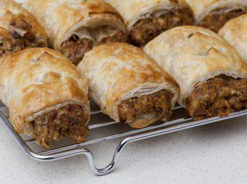 Home made sausage rolls on baking rack