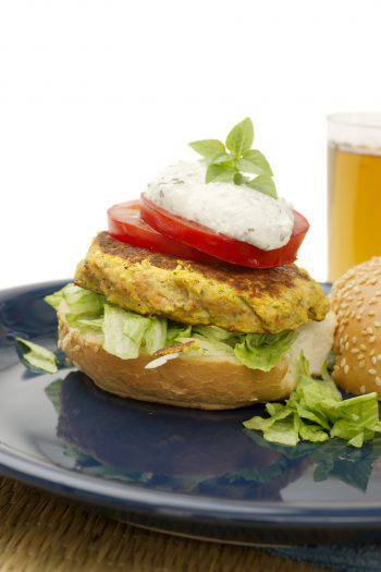 Vegetarian chick pea burger with tomato and basil pesta.