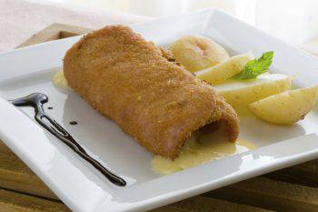 cheese stuffed meat roll with boiled potatoe and mint leaves