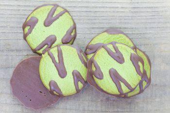 Chocolate and Macha green tea cookies on wood table background