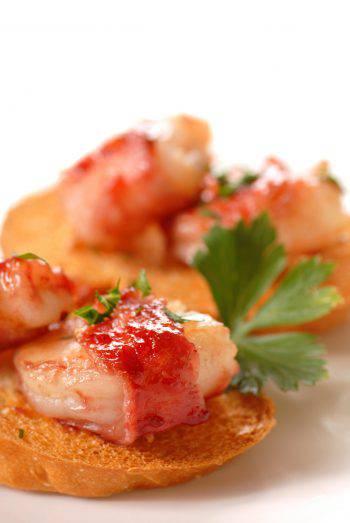 Bacon wrapped shrimp crostini with a cranberry apple glaze