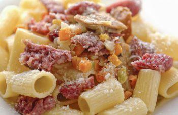 Closeup rigatoni pasta with sausages and mushrooms