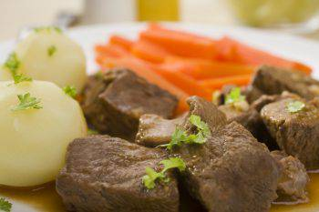 Close up shot of beef stew with potatoes and carrots. More good plain food:-