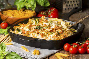 Baked pasta with broccoli, cauliflower, cheese and bechamel sauc