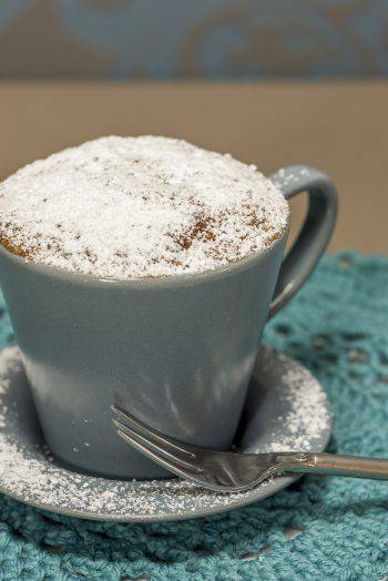 cupcake made in a coffee cup, with powdered sugar