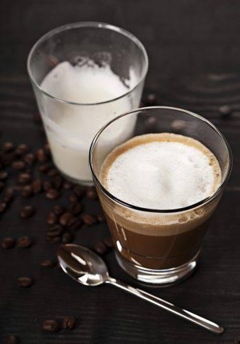 Cortado coffee drink in glass