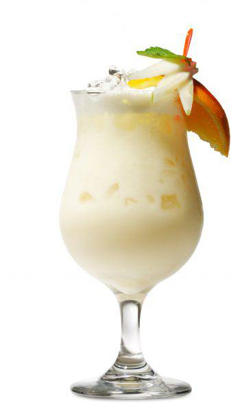 Glass of pi_a colada cocktail with fruit and straw