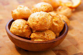 Bowl of cheese gougeres on table