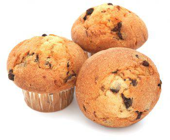 Three chocolate chip muffins isolated on white. Focus on foreground muffins.