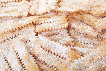 Chiacchiere, italian Carnival pastry background