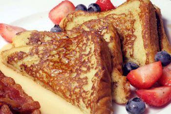 This is an image of french toast and berries.
