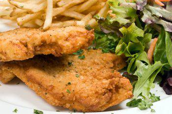 Breaded chicken, salad, and fries