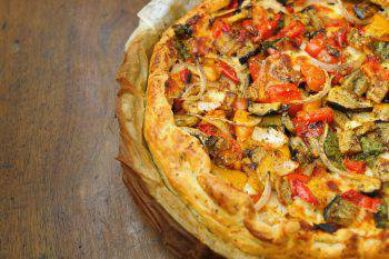 Homemade Cheese and Vegetable Pizza Pie in Greaseproof Paper