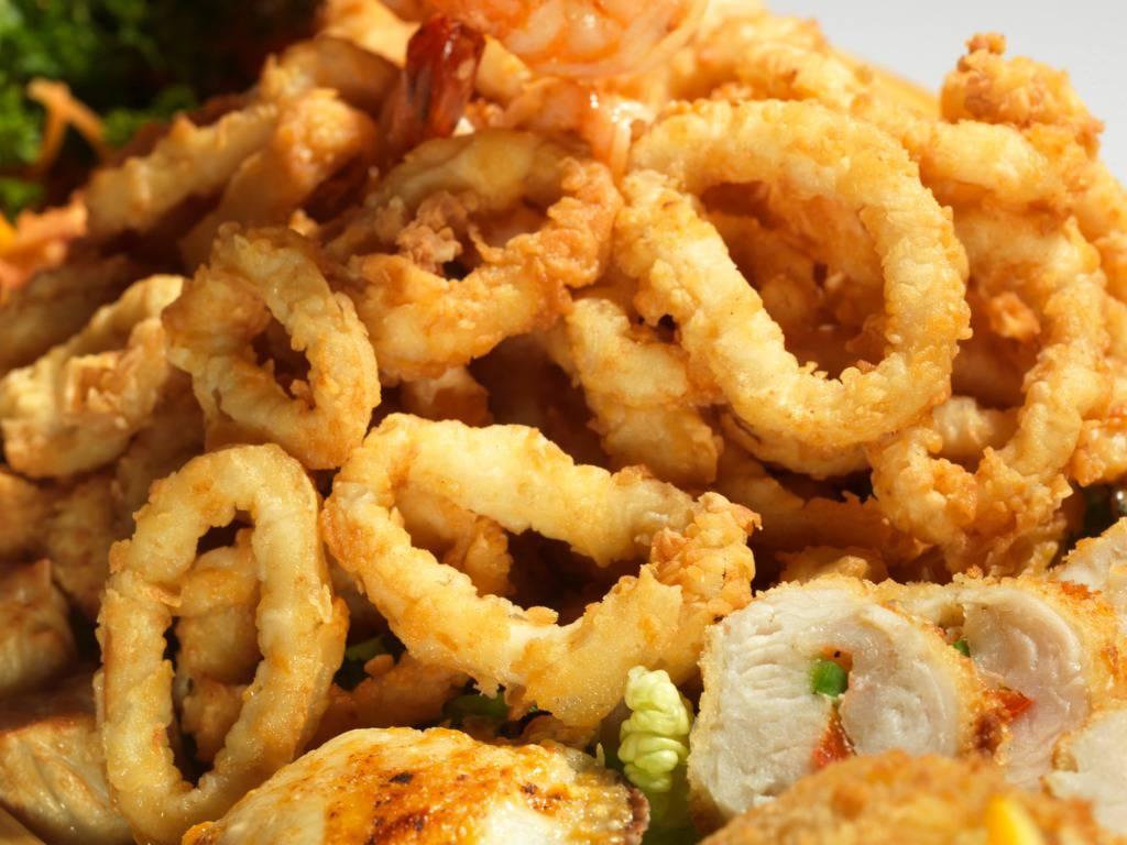 Anelli di totano al forno, una portata di mare leggera e irresistibile