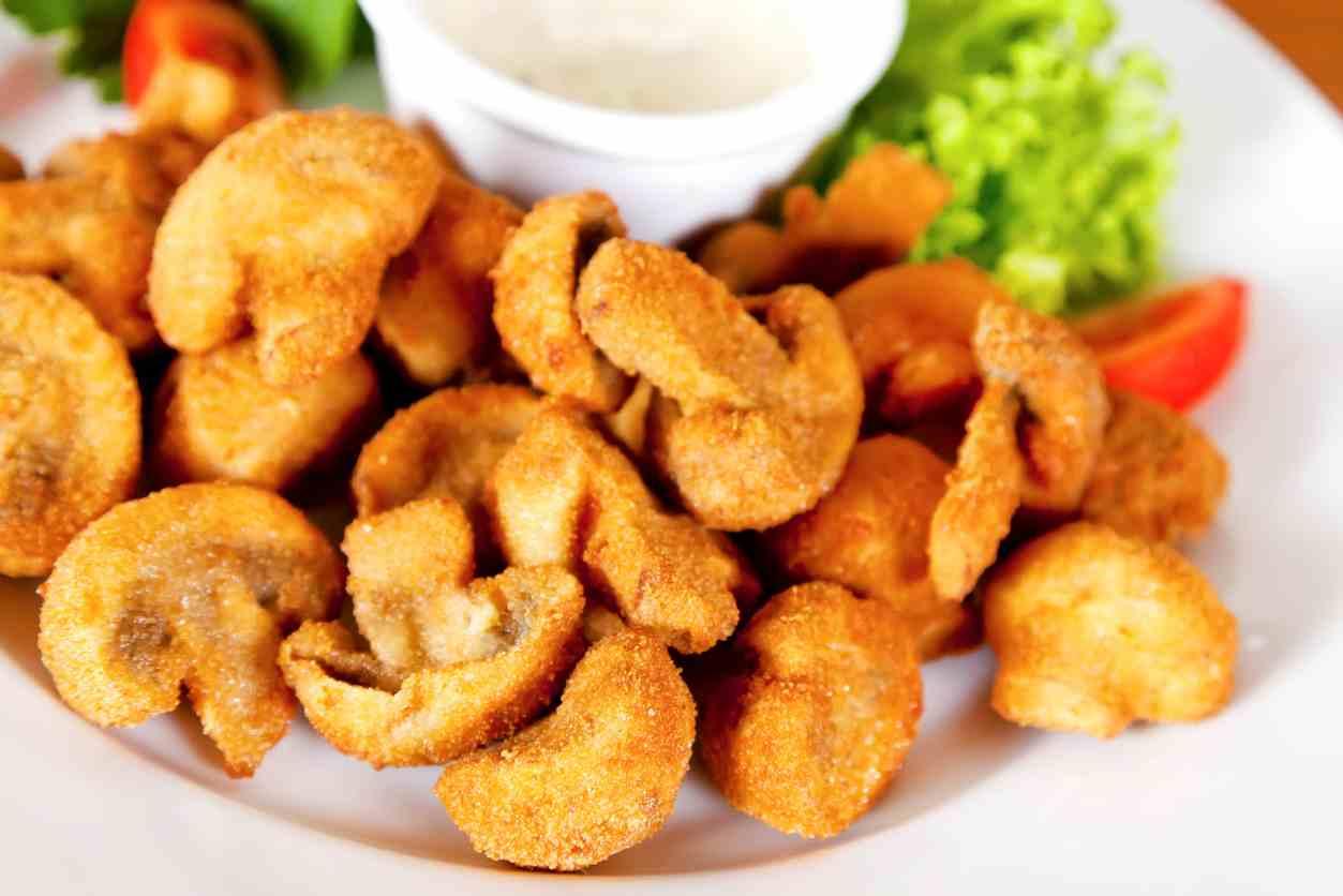Funghi gratinati al forno, un contorno gustoso e veloce da preparare